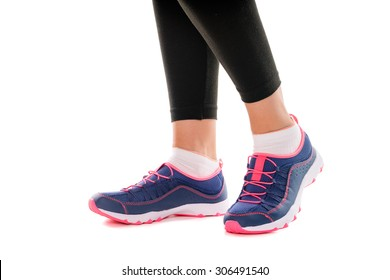 Sport and fitness. Close up of female feet with snickers. Isolated on white,