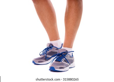 Sport and fitness. Close up of male feet with snickers. Isolated on white.