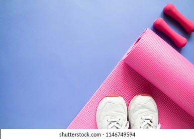 Sport and fitness equipments on purple colour background, Top view beauty and healthy concept