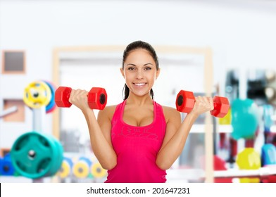 sport fitness excited happy woman, young healthy girl smile gym exercises dumbbells working out in gym