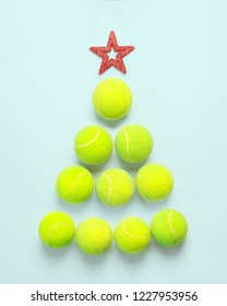 sport, fitness, game and objects concept - Christmas and New year concept with tennis balls top view. Light green tennis balls making a shape ofa tree