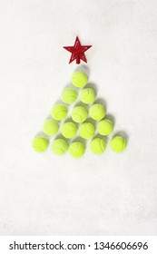 sport, fitness, game and objects concept - Christmas and New year concept with tennis balls top view. Light green tennis balls making a shape of a tree