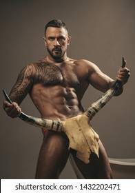 sport and fitness, health. brutal sportsman hold animal skull. steroids. muscular macho man with athletic body. sexy abs of tattoo man. male fashion. confidence charisma. nude male body. seduction.