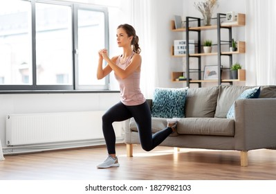 sport, fitness and healthy lifestyle concept - young woman exercising at home