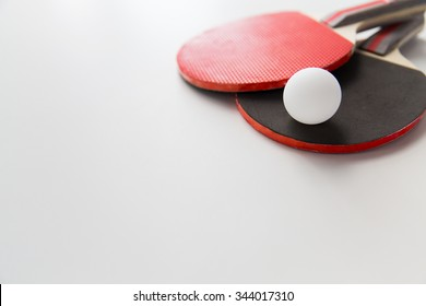 sport, fitness, healthy lifestyle and objects concept - close up of ping-pong or table tennis rackets with ball