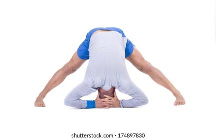 Sport fitness man doing yoga exercise. Isolated on a white background. Studio shot
