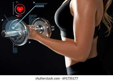 sport, fitness and people concept - close up of young sporty woman exercising with dumbbell and pulse