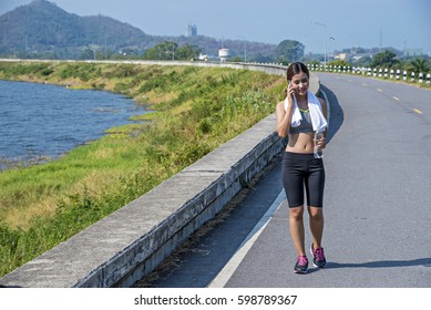 sport and fitness runner woman running on road training for marathon run doing high intensity interval training sprint workout outdoors
