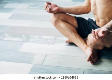 sport fitness and stamina training. physical exercising for strong body and healthy mind. yogi in a lotus pose relaxing and meditating.
