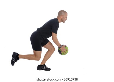 Sport Fitness trainer exercising with a power ball in gym, isolated over white background