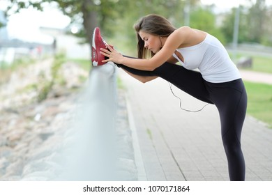 Sport, fitness. Woman is exercising on the street