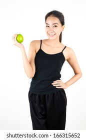 Sport girl with green apple