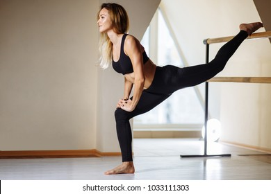 sport girl smiling and stretching the body in fitness class