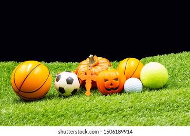 Sport Halloween with basketball football basketball golf ball and tennis are on green grass