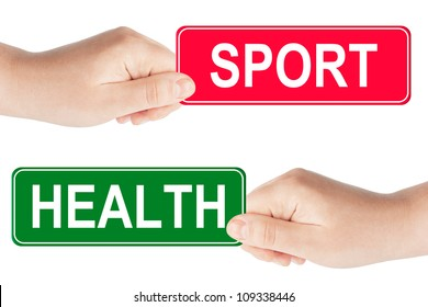 Sport and Health traffic sign in the hand on the white background