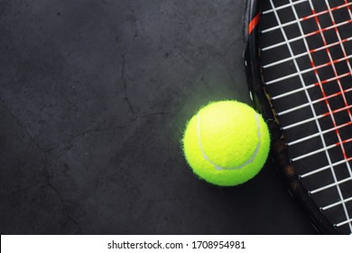Sport and healthy lifestyle. Tennis. Yellow ball for tennis and a racket on table. Sports background with tennis concept.
