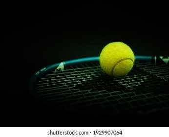 Sport and healthy lifestyle. Tennis. Yellow ball for tennis and a racket on table. Sports background with tennis concept. photo