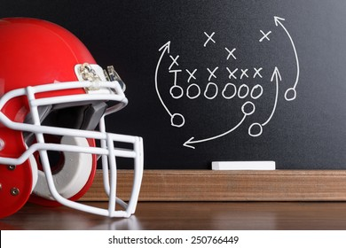 Sport Helmet In Front Of A Chalkboard With Football Play Strategy