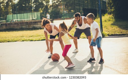Sport is important in life. Family playing basketball.