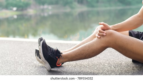 Sport injury, A man has knee pain during outdoor exercise