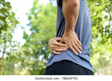 Sport injury, A man has lower back pain with outdoor exercise
