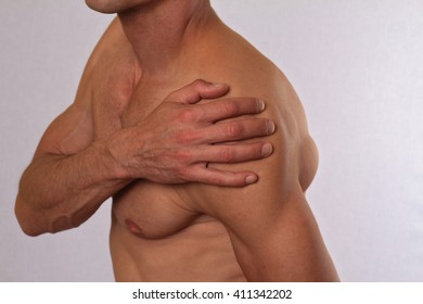 Sport injury, Man with shoulder pain. Pain relief concept