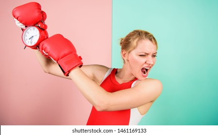 Sport lifestyle and healthy regime. Habits and regime concept. Improve yourself. Overcome harmful habits. Time for training. Get used to personal regime. Girl athlete boxing gloves and alarm clock.