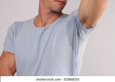 Sport man armpit sweating. Transpiration stain. Hyperthyroidism concept