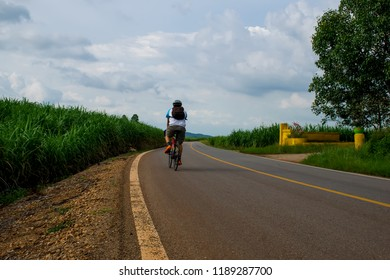 sport man.Man with bicycle riding country road,Thailand.