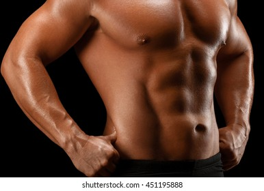 Sport man body studio on black background