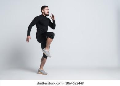 sport man or bodybuilder exercising on white background