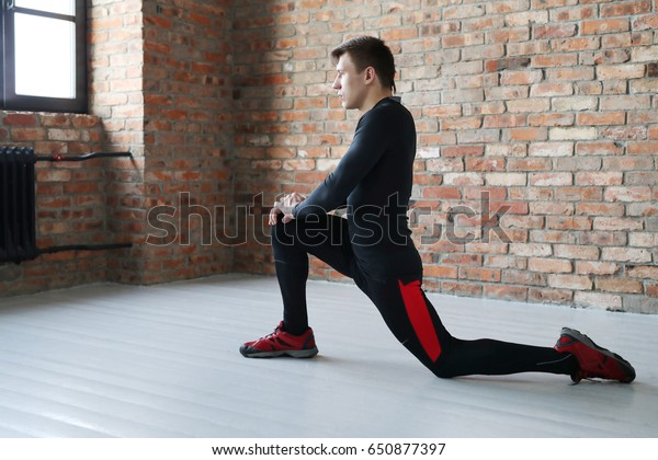 Sport. A man is exercising in the gym