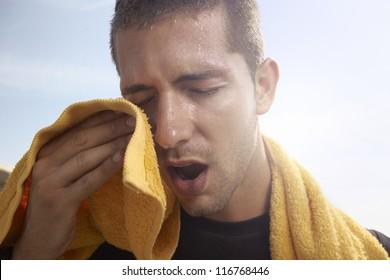 sport man resting after a hard workout