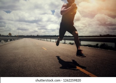 Sport man with runner on the street be running for exercise.