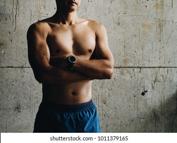 Sport man with weight training in fitness.