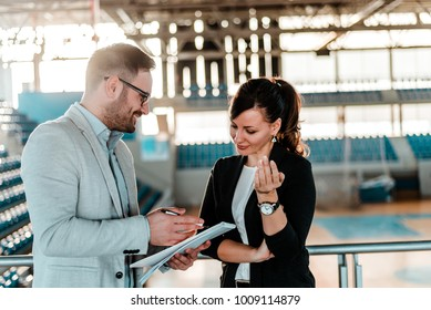 Sport manager negotiating.