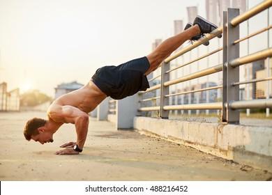 Sport men doing push-ups during outdoor cross training workout