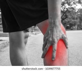 Sport men injury. male athlete jogger wearing man runner massaging calf muscle before workout.