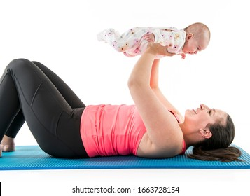 A Sport motherhood and active lifestyle of young mother workout together with her baby
