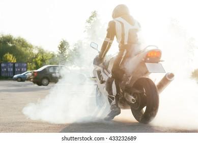 Sport motorbike wheel drifting and smoking on track.