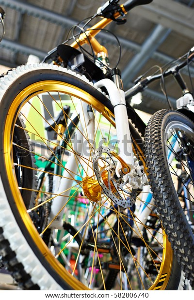 Sport mountain bike in a bicycle shop. Front view