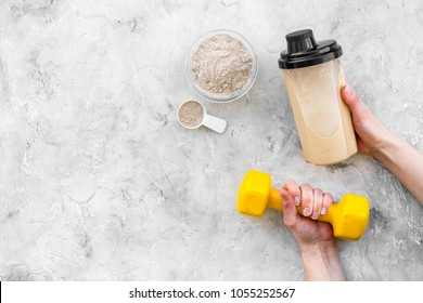 sport nutrition set with protein powder for cocktail and bars gray stone background top view space for text