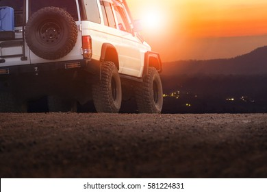 sport offroad vehicle on dirt field against sun set sky for traveling and outdoor lifestyle