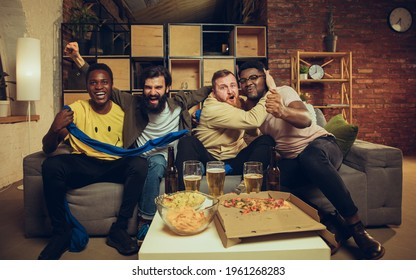 Sport party. Group of friends watching TV, sport match together. Emotional fans cheering for favourite team, watching football. Concept of friendship, leisure activity, emotions. Betting, finance, fun
