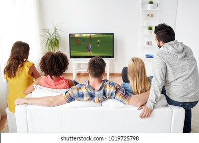 sport, people and entertainment concept - friends or football fans watching soccer game on tv at home