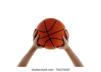 Sport and recreation, woman holding basketball. Isolated on white background.