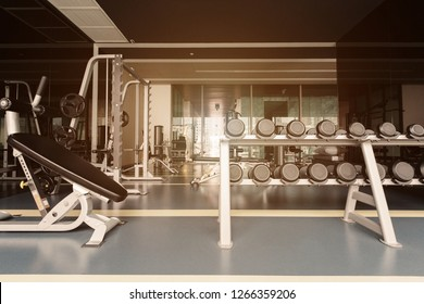 Sport room with dumbbells and fitness equipment