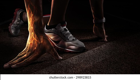 Sport. Runner. Hands on starting line. Power in the veins. Fire and energy