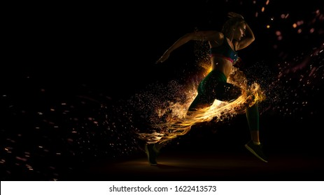 Sport. Runner. Side view of a jogger athlete with the power isolated on black. Fire and energy - Shutterstock ID 1622413573