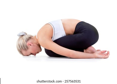 Sport Series: Young Blonde Woman doing Yoga . Childs Pose